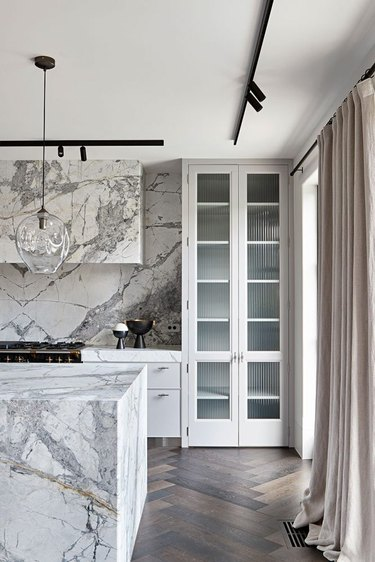 gray and white kitchen with marble