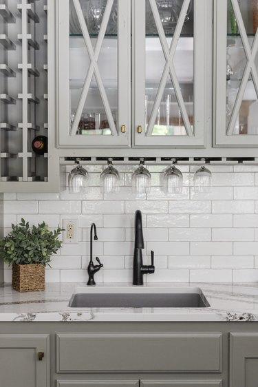Farmhouse style kitchen with white subway tile backsplash