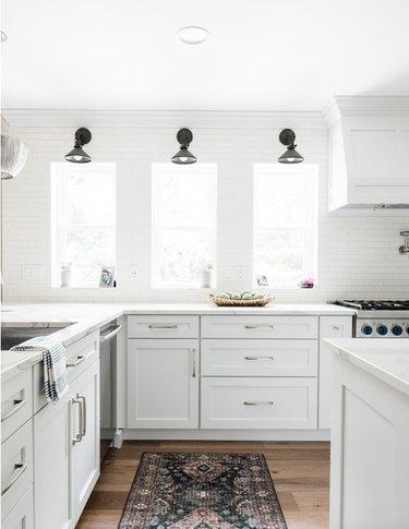 White farmhouse kitchen with subway tile