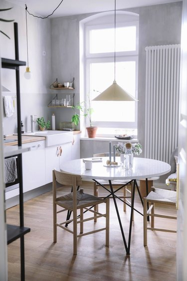 gray and white kitchen with plaster walls