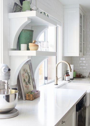 white open shelving with decor in industrial farmhouse kitchen