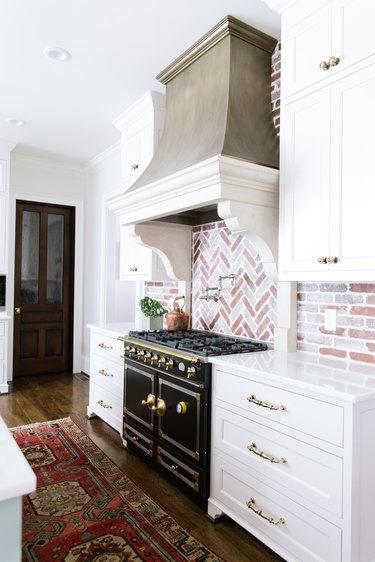 Brick backsplash in farmhouse kitchen