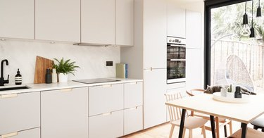 moden gray and white kitchen with flat panel cabinets
