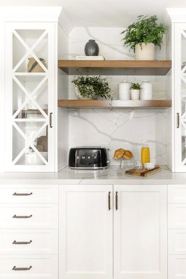 Marble backsplash in a kitchen designed by JLK Interiors