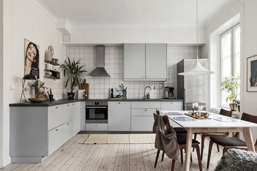 gray and white kitchen with stainless steel appliances