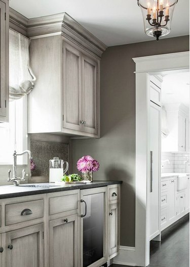 distressed cabinets in gray kitchen