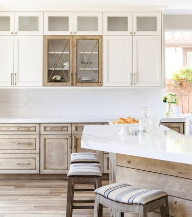 kitchen with distressed lower cabinets