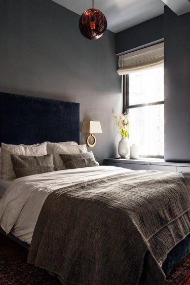 dark bedroom with gray walls