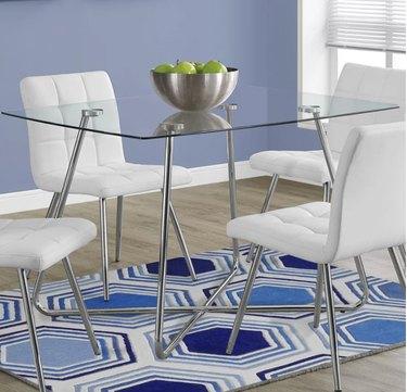 Glass top metal leg dining table