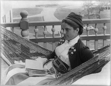 A woman in a hammock at the Kineo House in Maine, photographed by Joseph John Kirkbride.