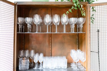 glassware in wood cabinet