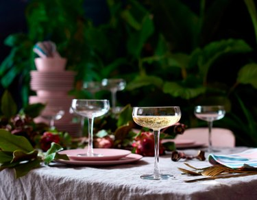 table with plates and champagne coupes