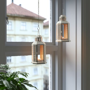 two lanterns for tealights hanging near window