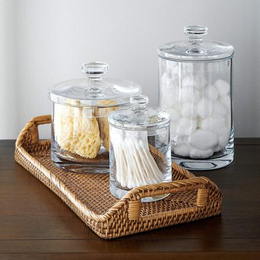 rattan tray with bathroom products