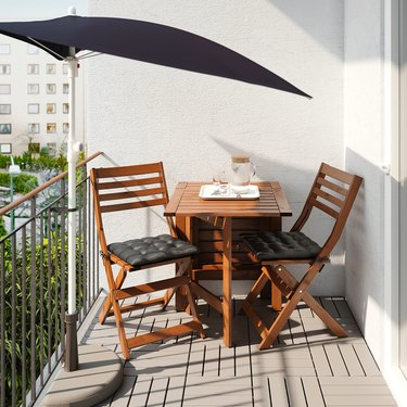 balcony with table and umbrella