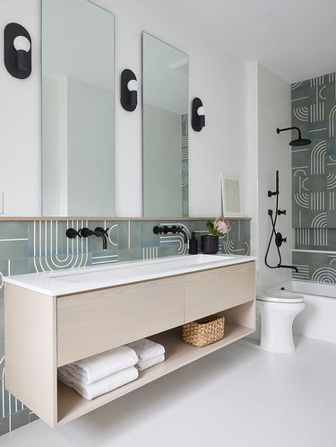 soothing gray and white bathroom with geometric tile