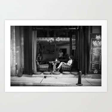 black and white print of someone at coffee shop
