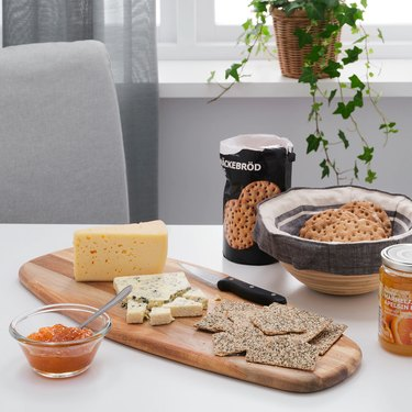 table with cutting board with snacks