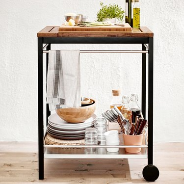 serving cart with wheel and various dishes