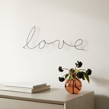 Love wall sculpture in metal