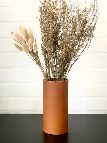 leather vase with detailed stitching