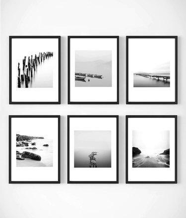 six framed coastal photographs
