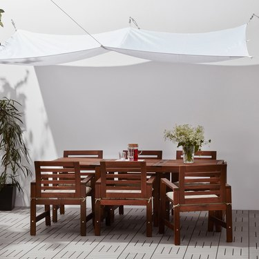 wood table with white canopy above