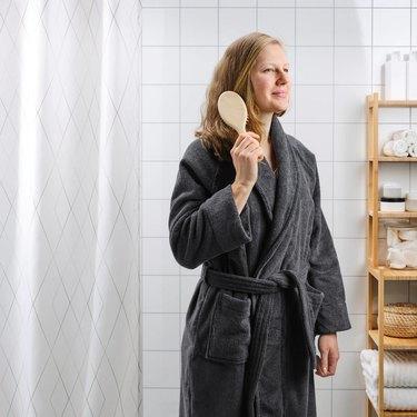woman in gray bathrobe
