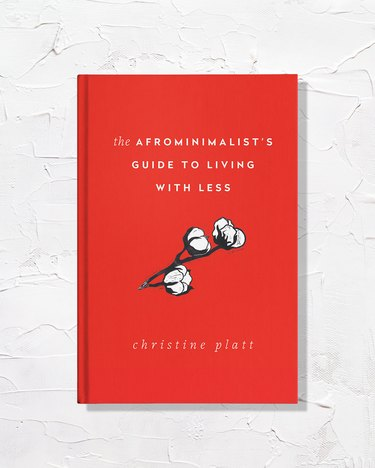 """red book with title """"The Afrominimalist's Guide to Living With Less"""""""