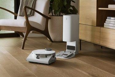 chair and dresser near robotic vacuum
