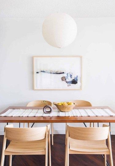 white minimalist dining room with paper lantern