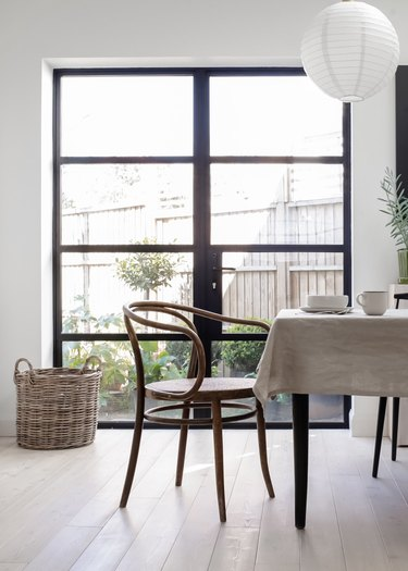 vintage chair at table in minimalist dining room
