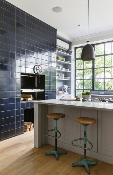 kitchen accent wall with tile framing wood burning stove