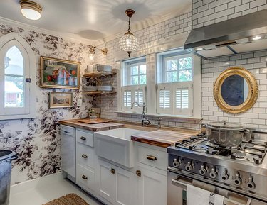 floral kitchen accent wall with white cabinets and backsplash