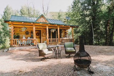 cabin with chairs and fire pit