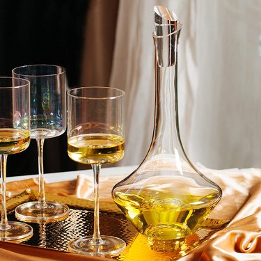 Decanter with wine and glasses
