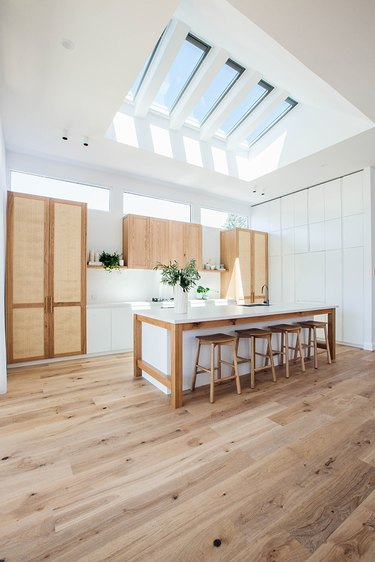 open kitchen with skylights and wood flooring