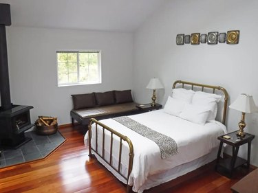 room with bed and couch with night stand with lamp