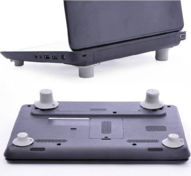 Heat reduction feet for laptop