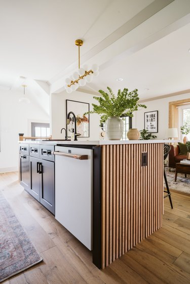 open kitchen with modern wood and black island