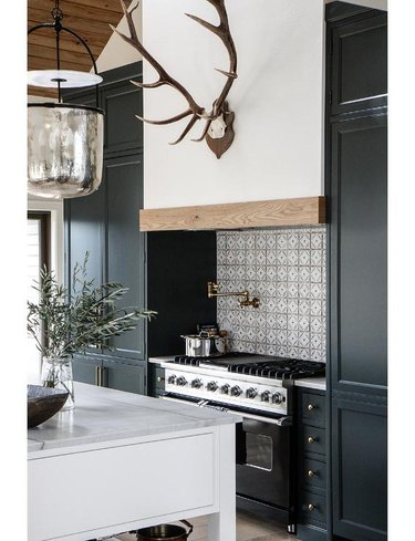 Spanish style kitchen with black cabinets