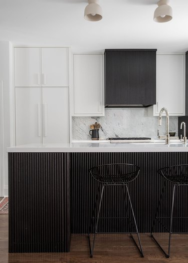 modern kitchen with reeded cabinets in espresso finish