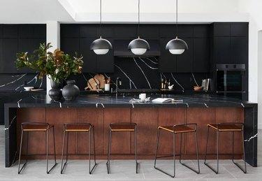modern black and wood kitchen with black kitchen appliances