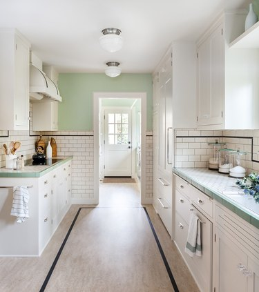 retro inspired kitchen with green and white tile