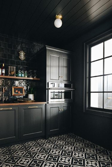 black kitchen pantry with paneled ceiling