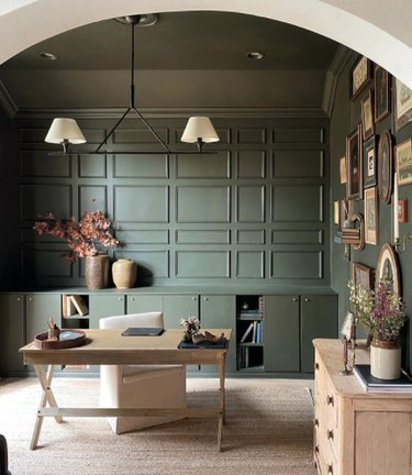 Home office space with green walls