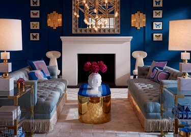 Maximalist living room with deep blue walls