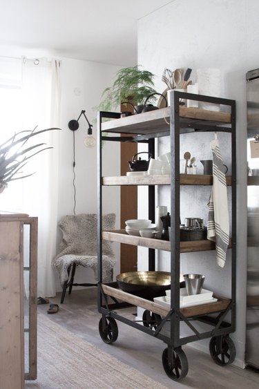 industrial kitchen with wood and metal storage cart