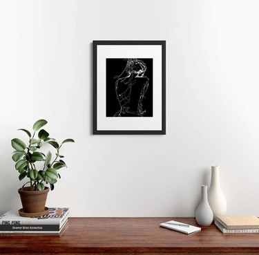 Framed drawing over wooden table