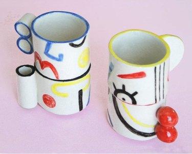two stacks of colorful mugs